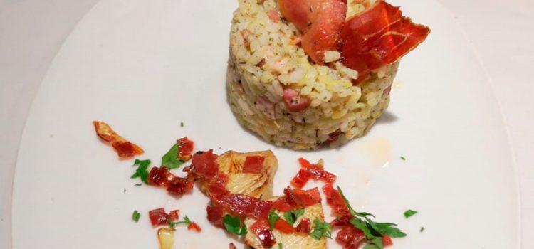 Café Bar Rick´s > Timbal de arroz con papada, alcachofa y jamón